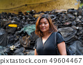 Young beautiful Asian tourist woman backpacker in dirty alley 49604467