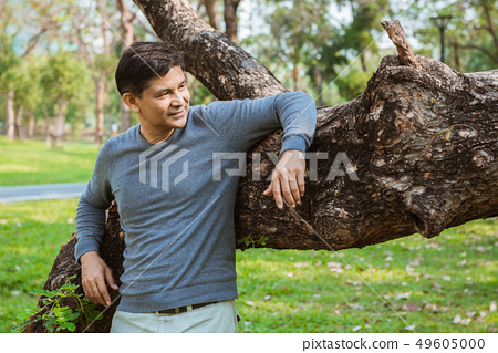 A happy middle age man relax in the park 49605000