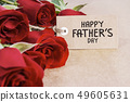 Red roses with fathers day card on brown paper 49605631