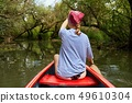 Canoeing on a lake 49610304