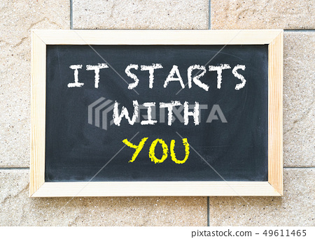 It starts with you, words on blackboard 49611465