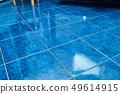 Tiled bathroom floor 49614915