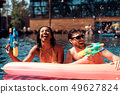 Young Smiling Couple having Fun in Swimming Pool 49627824