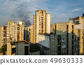 Smoke of a fire above buildings 49630333