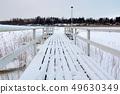 White snowy footbridge in frozen water, cold 49630349