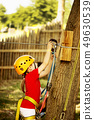 Little brave caucasian girl treerunner fasten the rollclip before climbing 49630539