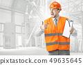 The builder in orange helmet against industrial background 49635645