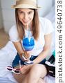 Woman enjoying summer vacation in an hotel room 49640738