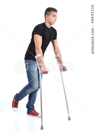 Man walking with crutches 49643316