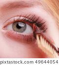 Closeup part of woman face eye makeup detail. 49644054