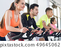 People exercising at fitness center 49645062