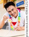 Bartender stirring cocktail 49645257