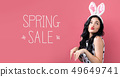 Spring sale message with woman with Easter theme 49649741