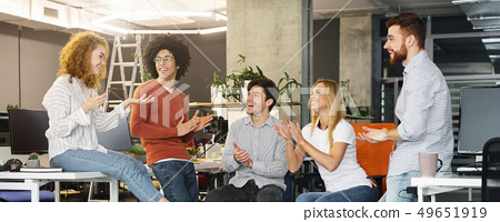 Group multiethnic business people applauding to new member of team 49651919