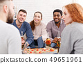 Friends meet together. Students eating pizza and talking 49651961