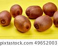 Close up group of whole kiwi fruits. 49652003