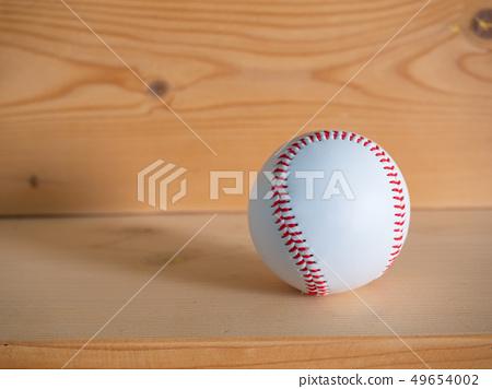 baseball on the wood floor. 49654002
