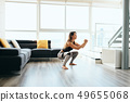 Adult Woman Training Legs Doing In and Out Squat 49655068