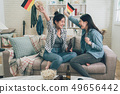 asian women waving German flag together celebrate 49656442