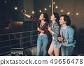 young people in rooftop party taking selfie 49656478
