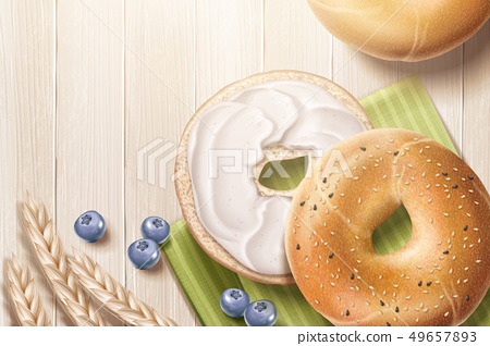 Delicious bagel on wooden table 49657893