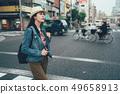 woman pedestrian walking to cross the road 49658913