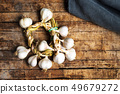 Garlic on a rustic wooden table top view 49679272