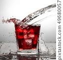 glass with ice and liquid splash 49680057