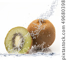 fresh kiwi falling in water 49680398