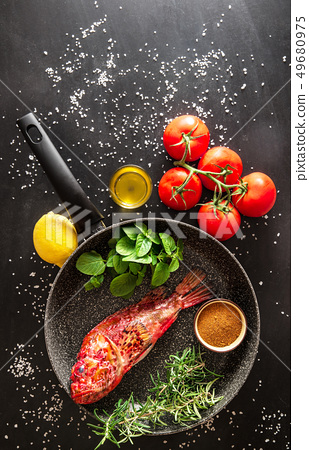 preparation of a grilled fish 49680975