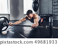 The athlete trains hard in the gym. Fitness and healthy life concept. 49681933