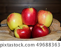 Close-up of ripe red yellow apples in a wooden 49688363