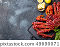 Red king crab on gray background. King crab, lemon and cilantro, top view 49690071