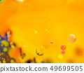 Spheres and multicolour pattern on abstract orange 49699505