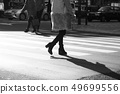 Image of a woman walking in a crowded area of Shinjuku (Tokyo) 49699556