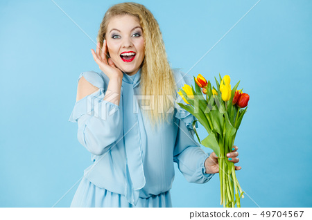 Pretty woman with red yellow tulips bunch 49704567