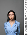 Woman in blue dress 49714664