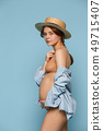 Young beautiful pregnant woman posing on blue background 49715407