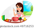 Beautiful woman cooking in her kitchen 49716253
