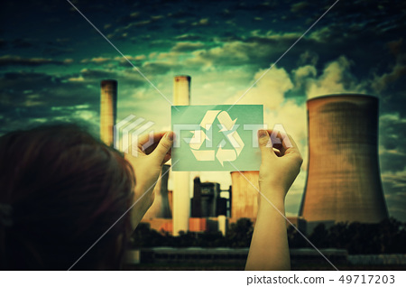 holding recycle symbol 49717203