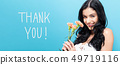 Thank you message with young woman holding carnations 49719116