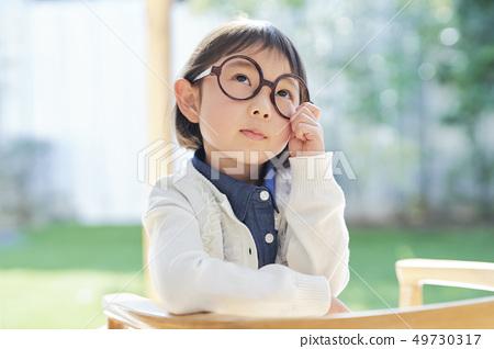Girl child portrait 49730317
