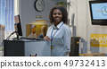 Customer service manager standing by desk 49732413