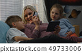 Mother and children shopping online 49733006