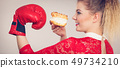 Woman boxing cream cupcake 49734210