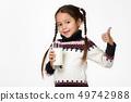 little child girl holding glass of milk on white background 49742988
