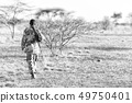 a black soldier and his gun looking the  boarder 49750401