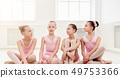 Little ballerinas talking in ballet studio 49753366