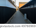 A view of the back alley with a charcoal wall in the Kurashiki beauty area 49760969
