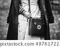 Re-enactor Wears Historical German Nurse Paramedic Of World War II Uniform With First Aid Kit. Photo 49761722